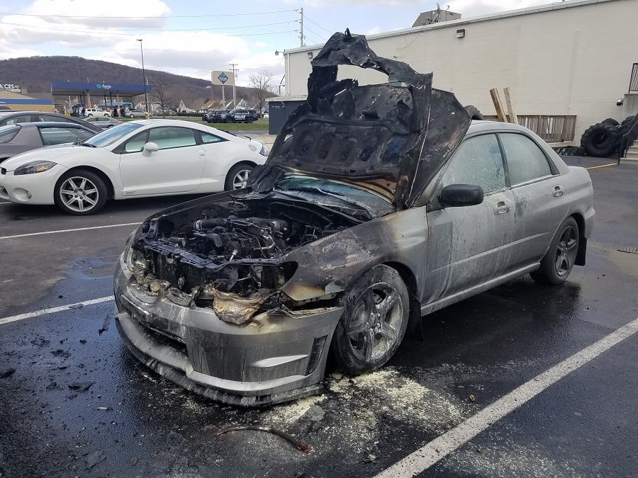 Working Car Fire Behind Dino's